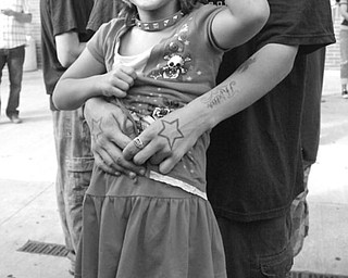 The Vindicator/Robert K. Yosay -----VEXFEST 6 - Its all music as Angelina 7 with her dad Jason Smith of Niles listens to the music on Stage West  - 9-23-2009