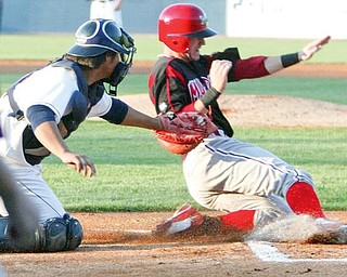 Muckdogs Devin Goodwin is out at the plate during 1st inning Tuesday. Scrappers catcher Chen Chun makes the tag.