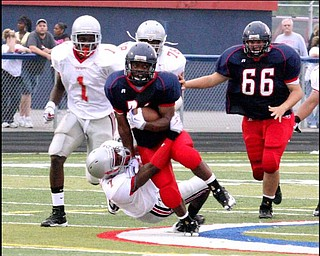 FITCH - CHANEY - (21) Bruce Reed of Fitch is brought down by (7) Terrance Mackie during their game Friday night. - Soecial to The Vindicator/Nick Mays