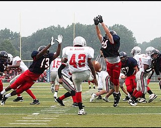 FITCH - CHANEY - (13) Will Mahone and (58) George Thomas of Fitch go for the block of Malcolm Adams' punt during their game Friday night. - Special to The Vindicator/Nick Mays