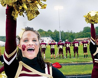 Liberty HS senior cheerleader ShelbieStefanski shows her school spirit during Friday game with East.wdlewis