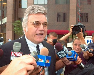 **FILE** This July 30, 2002 file photo shows former Rep. James Traficant Jr. in Cleveland, Ohio. Traficant has told freinds he wants to keep a low profile following his Sept. 2 release from prison, but  organizers say they've sold about 1,000 tickets to a homecoming dinner for the ex-Ohio congressman. (AP Photo/Mark Duncan, File)