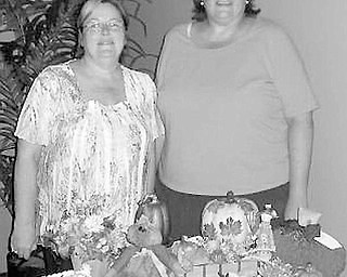 Special to The Vindicator SHOW TIME: Some of the Chinese auction items that will be available Sept. 20 at the fashion show planned by the ABWA Network Council have been sorted by, from left, Cathy Pokrivnak and Karen Blasko, chairmen of the event.