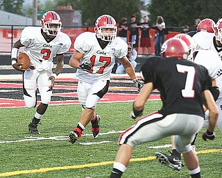 STRUTHERS - GIRARD - (3) Jermayne Brooks follows the blocking of (17) Keith Auman as (7) Gino Mariano of Girard comes up on defense. - Special to The Vindicator/ Nick Mays