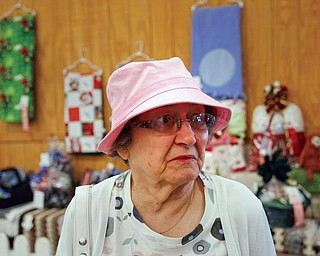 The Vindicator/Robert K. Yosay -----BUCKET LIST CHECK OFF -  Eleanor Kalasky was asked by her son  to come to the fair after 20 years.. abscence.. she always loved the fair and the crafts as she toured the fine arts bldg.--942009-
