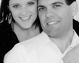 Courtney E. Alderman and John Finizio III