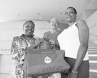 The Vindicator/Robert K. Yosay ---l-r   Lynette Sutton Nikki Davis  Marcia Haire- Ellis  at the Delta Sigma Theta Black Excellence Awards -- 08252009-