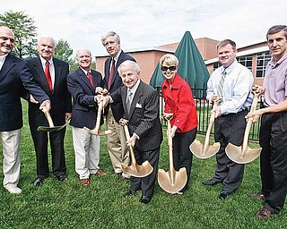 ALL SMILES: Dignitaries break ground for the $6 million expansion of the D.D. & Velma Davis Family Branch of the YMCA in Boardman. Participating in Thursday's event were, from left, Greg Strollo of Strollo Architects; C. Robert Buchanan, a YMCA board member; Ken Rudge, president and chief executive officer of the Youngstown YMCA; John Yerian, chairman of the YMCA's trustee board; Tony Lariccia, businessman and philanthropist, and his wife, Mary; Doug Lumsden Jr.; and Tom Grantonic, Boardman Y director.