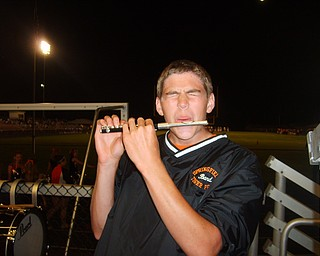 Trying something new: Percussionist Tim Norris of the Springfield Local Marching Band gives the piccolo a try before the half time show.