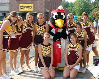 South Range cheerleaders hang out with YSU's Pete the Penquin at the
