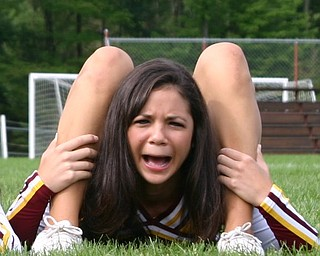 South Range Cheerleader Kim Miglets is not sure her legs should bend