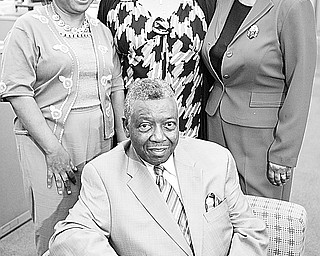 <p>ANNIVERSARY EVENT: Looking forward to the 90th annual Freedom Fund Banquet to be sponsored by Youngstown NAACP Branch are, from left, Jo Anne Wright, director of publicity; Juanita Bryd, cochairman, and Beverly Fortune, chairman, who are standing behind Herbert Williams, ticket chairman.</p>