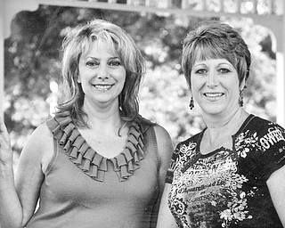 <p>GOING TO MARKET: Prepared to shop at the Market on the Green are, from left, Rhonda Rance and Danielle Strock, members of Canfield Junior Women's League and chairwomen of the fundraiser. </p>