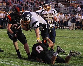 MCDONALD - MINERAL RIDGE - (3) Nick Cupan of Mcdonald dives into the end zone over (8) Kyle Butson during their game Friday night. - Special to The Vindicator/Nick Mays