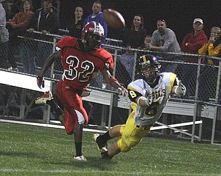 CRESTVIEW - COLUMBIANA - (8) Jacob Danks lays out for the ball as (32) Mardell Halas plays defense during their game Friday night. - Special to The Vindicator/Nick Mays