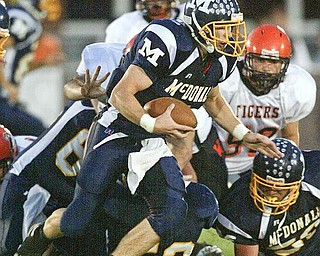 Nick Cupan of McDonald scrambles for yardage during Friday game with Wellsville. wdlewis