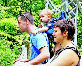 Jodi, John and 11 month old Evan Kelly of Youngstown, were out for a stroll on the Suspension Bridge