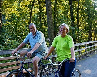 Tim and Ingrid Cassidy of Boardman stopped to chat before heading off across the Lanterman Falls Bridge