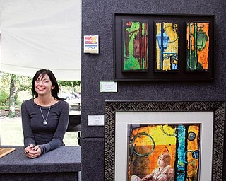 Artist Jenn Cole of Liberty uses mixed media for her work.