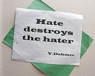 THE MESSAGE: One of the quotes on a bulletin board at Chaney Middle School is shown. The quotes, coupled with surveys and presentations, are designed to reduce violence in the Youngstown school district.