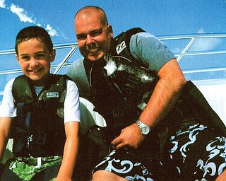 Nicholas Workman, 9, and Scott Workman were parasailing in Madeira Beach, Fla., in June.