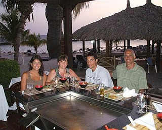 Lisa and Dominic Pannunzio, along with their children Andrea and Anthony, enjoy dinner cooked outdoors on the beach on the island of Curacao, part of the Netherland Antilles.