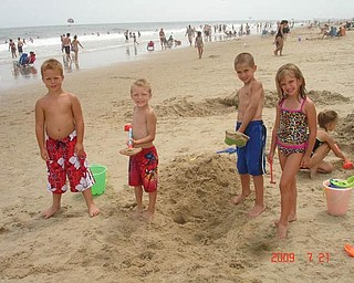 Friends Ronnie Hryb, 8, Zachary Hryb, 6, Michael Cougras, 8, and Connie Cougras, 6, enjoy a day at the beach in July.