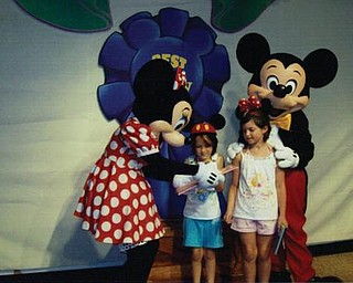 Autumn and Amber Murzda of Hubbard met Minnie and Mickey Mouse at Disney World in Florida in July.