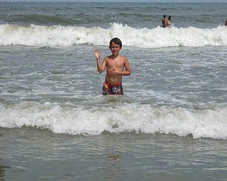Kyle Mamounis, 9, was on vacation in Florida in July with his grandparents. This was his first time in the Atlantic Ocean, at Cocoa Beach.