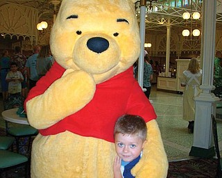 Nicholas Colbert enjoyed some time with Winnie the Pooh after a fabulous lunch at the Crystal Palace in Walt Disney World this past summer.