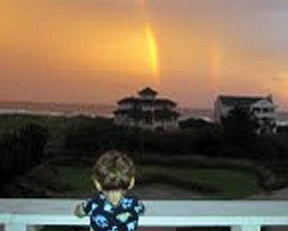 Recently Anthony and Nora Pilolli of Boardman spent a week on Figure Eight Island, N.C. with the family of daughter and son-in-law, Sherri and Tom Meyer of Lynchburg, Va. This is a picture of their grandson, Oliver Meyer, checking out the rainbows after a rainy day.