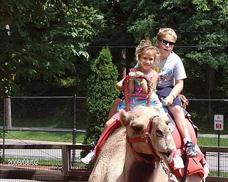 Matthew and Julia Ranno, children of Sam and Donna Rano of Poland, enjoy a camel ride at the Cleveland Zoo.