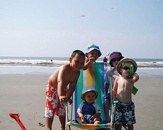 The Carcelli family vacationed in North Myrtle Beach. From left are Dominic and Ryan Carcelli of New Middletown, Gino Carcelli of Ravenna, and Nicholas and Tyler (sitting) Carcelli of (Mayfield Heights.