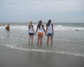 'More backs in Myrtle Beach' shows, from left, Laura Tinkler of Canfield High School, Leah Callaway of Boardman High School, and Natalie DeGenova of Poland High School.