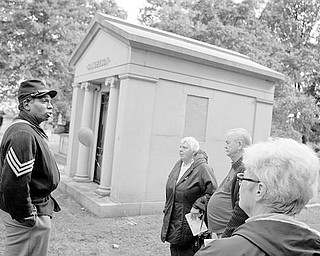 HISTORIC EVENT: GThe Mahoning and Shenango Valley Historical Club gave a presentation Saturday at the South Side cemetery. Steffon Wydell Jones is dressed as a Civil War soldier as he talks about the life of Thomas W. Sanderson, a former Youngstown mayor who is buried in this mausoleum. Listening are Virginia and Ed Mannion of Columbiana and Alma Gabriel of Warren.