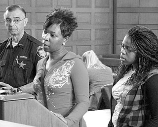 LIFE IN PRISON: Brittnay McCoy, left, and her sister, Chelise McCoy, took turns speaking about Eugene Cumberbatch, who was sentenced to life in prison for his role in the April 13 deaths of their brother Lloyd McCoy Jr., 11, and Marvin Chaney, 26. Deputy Nick Veri is pictured at far left.