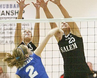 Hubbard's Lexi Starheim slips a shot past Salems Olivia Mitchley, left, and Amy Scullion.