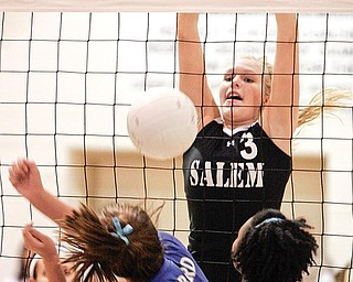 Salem's Olivia Mitchley blocks a shot by Hubbard's Jillian hinkle#21 at right is Hubard's Jackie Carlisle. wdlewis