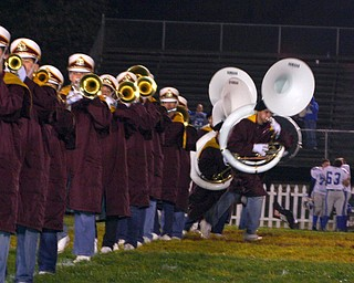 """The South Range tuba players take off on a tuba run during the halftime show."""
