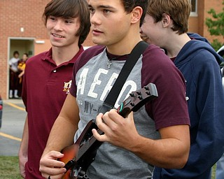 """Brrandon Homan rocks out with Guitar Hero at the Blitz tailgate party."""