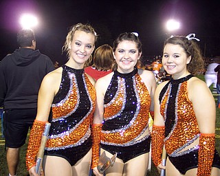 Born to Twirl: The Springfield Local Majorettes are all smiles before the half time show at South Range. From the left: Rebecca Platt, Amanda Dicks, and Amanda Lehnerd.