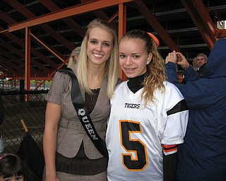 Springfield's Homecoming Queen, Ashley Davis and cousin, Megan Riley prepare for Friday night football.