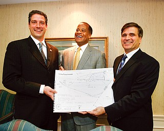 NEGOTIATIONS OVER: From left, U.S. Rep. Tim Ryan of Niles, D-17th, Youngstown Mayor Jay Williams and Girard Mayor James Melfi show a site plan for a 191-acre site along the Youngstown/Girard border that could be the location of a $970 million V&M Star Steel expansion. It took the two cities weeks to work out an agreement to annex the property, located in Girard, to Youngstown to clear the way for the project.