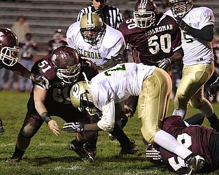 BOARDMAN - (51) Noah Patoray and (56) Ryan Phillis stop (22) Bobby Hamlet for no gain Friday night. - Special to The Vindicator/Nick Mays
