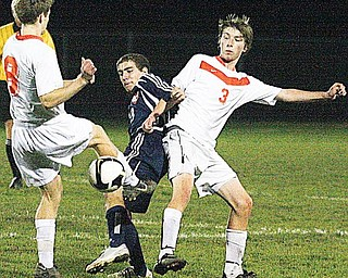 SOCCER - (3) Peter Nog ( ) of Howland tries to keep (11) away from the ball Wednesday night. - Special to The Vindicator/Nick Mays