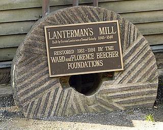 GRINDSTONE:  This grindstone is an example of the actual stones used in the milling of flour by Lanterman's Mill. The divots in the stone act as knives to remove the hard hulls of buckwheat and corn, and the flat surfaces grind the grains into flour, a mill official said.