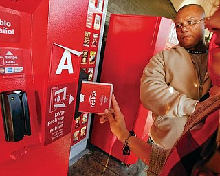 Enrique Cruz, left, and his wife Darlene Cruz return some DVD's at the Red Box movie rental vending machines outside Tony's Finer Foods on 4600 W. Belmont, October 6, 2009, in Chicago, Illinois.