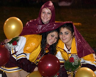 """South Range cheerleader, Emma Lewis, helps fellow cheerleaders Kim