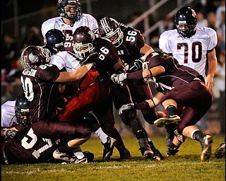 The Boardman defence sworm all over  Austintow's (13) Will Mahone during their game in Boardman on Friday night. Photo/Mark Stahl