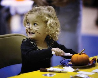 PURR-FECT PUNKIN: 2-year-old Hannah LaPlante was captured in this picture by her father, John, while she was painting a pumpkin at the Poland Halloween Parade last weekend.